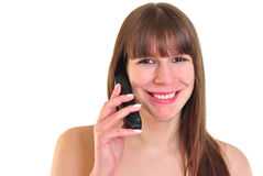 Young woman is talking on a phone Royalty Free Stock Photography