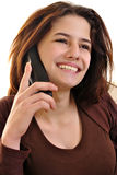 Young woman is talking on a phone Royalty Free Stock Photo