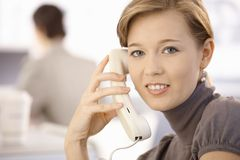 Young woman talking on phone Royalty Free Stock Images