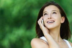 Young woman talking phone Stock Photos