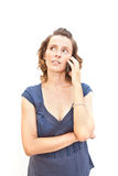Young woman is talking by phone Royalty Free Stock Photography