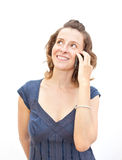 Young woman is talking by phone Royalty Free Stock Images