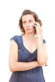 Young woman talking by phone Royalty Free Stock Images