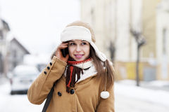 Young woman talking on the phone. Winter collection: portrait of beautiful woman in wintertime Stock Image