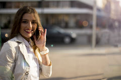Young woman talking on a phone Royalty Free Stock Photography