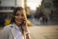 Young woman talking on a phone Royalty Free Stock Photos