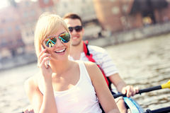 Young woman talking on the phone in a canoe Stock Image