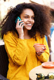 Young woman talking on the phone in coffee shop Stock Photos