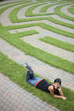Young Woman Talking on the Phone in a Grass Maze Royalty Free Stock Images