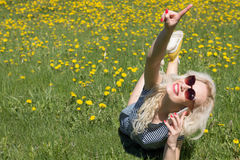 Young woman talking on the phone on the grass. Summer Concept Royalty Free Stock Photo