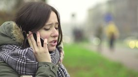 Young woman talking on the phone stock footage
