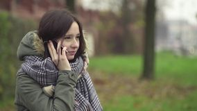 Young woman talking on the phone stock video