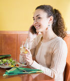 Young woman talking on the phone in restaurant Royalty Free Stock Images