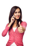 Young woman talking on the phone showing hand ok s Royalty Free Stock Image