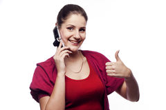 Young woman talking on the phone showing hand ok sign Stock Photography