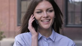 Young Woman Talking on Phone while Standing Outdoor stock video