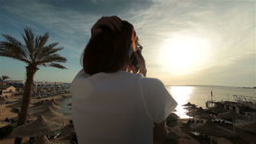 Young woman talking phone in sunset or sunrise stock video footage