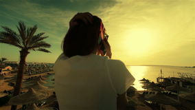 Young woman talking phone in sunset or sunrise stock video