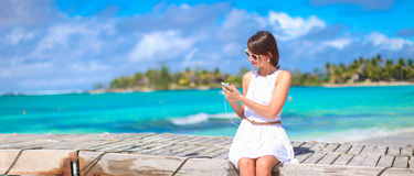 Young woman talking on phone during tropical beach Royalty Free Stock Photography