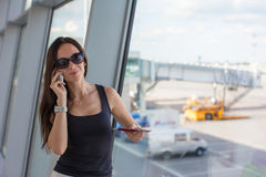 Young woman talking on the phone while waiting Royalty Free Stock Photos