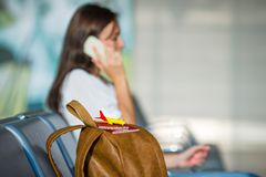 Young woman talking on the phone while waiting Stock Photography