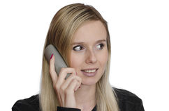 Young woman talking on the phone on white background Royalty Free Stock Photos