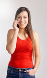 Young woman talking on smart phone. Portrait of young woman talking on smart phone Stock Photo