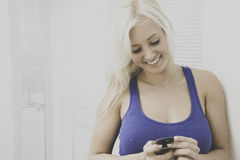Young woman talking on a smartphone Royalty Free Stock Photography