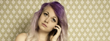 Young woman talking on a smartphone Stock Photography