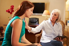 Young Woman Talking To Counsellor Using Digital Ta Royalty Free Stock Images