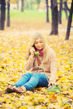 Young woman talking on vintage phone Stock Photography