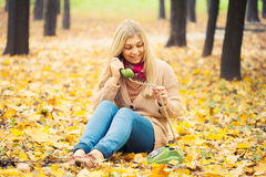 Young woman talking on vintage phone Stock Image