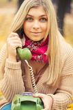Young woman talking on vintage phone Stock Images
