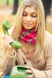 Young woman talking on vintage phone Royalty Free Stock Photography