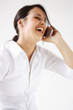 Young woman talks on cellphone Royalty Free Stock Images