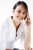 Young woman talks on cellphone Stock Photo
