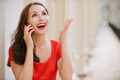 Young woman talks by mobile phone Royalty Free Stock Photo