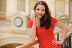 Young woman talks by mobile phone Stock Photos