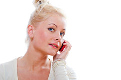Young woman talks by a mobile phone Stock Photography