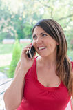 Young woman talks on phone Royalty Free Stock Photo