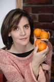 Young woman with tangerines Stock Photos