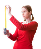 Young woman with tape. Young woman holding tape measure, isolated on white Stock Images