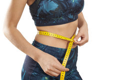 Young woman with tape measure around waist stock photography
