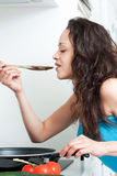 Young woman tasting Royalty Free Stock Photo