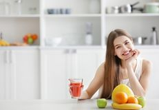 Young woman tasting fresh juice Royalty Free Stock Images