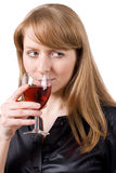 Young woman tasting a glass of wine. #1. Young woman tasting a glass of wine. Isolated on white. #1 stock photos
