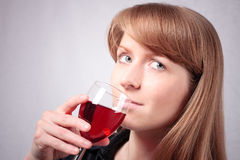 Young woman tasting a glass of wine. #3. Young woman with a glass of red wine. #3 royalty free stock photos