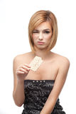 Young woman tasting healthy bread and hating it Stock Images