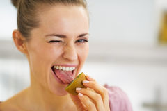 Young woman tasting kiwi Royalty Free Stock Photos