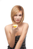 Young woman tasting a lemon Royalty Free Stock Photo